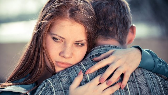 Unhappy couple hugging