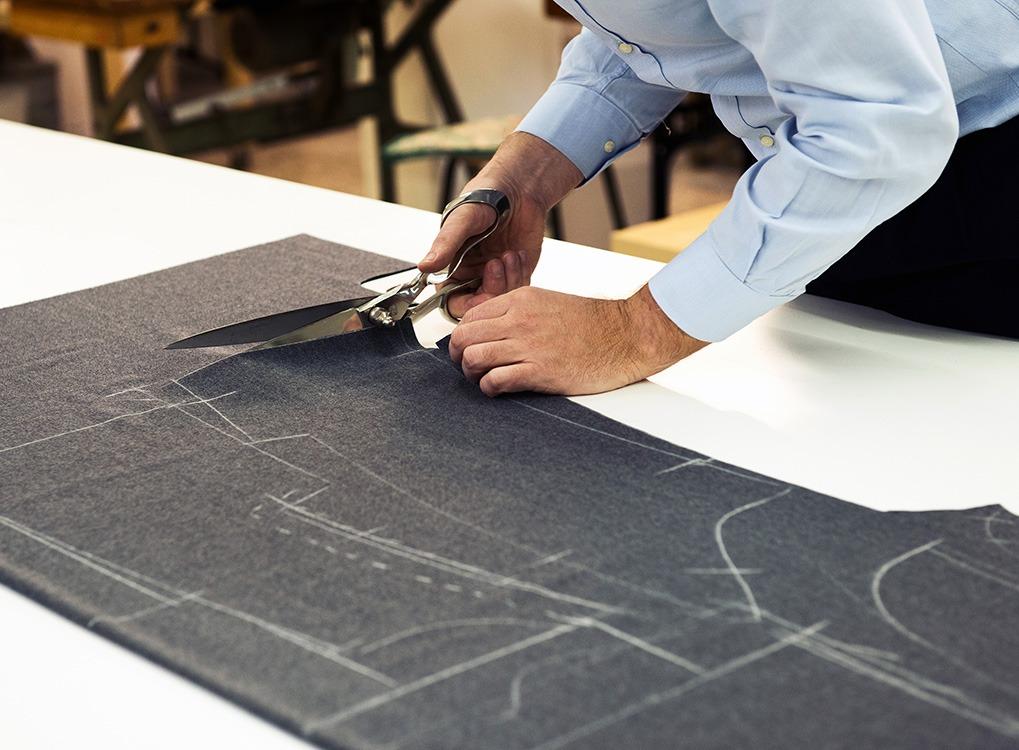 tailor making a suit