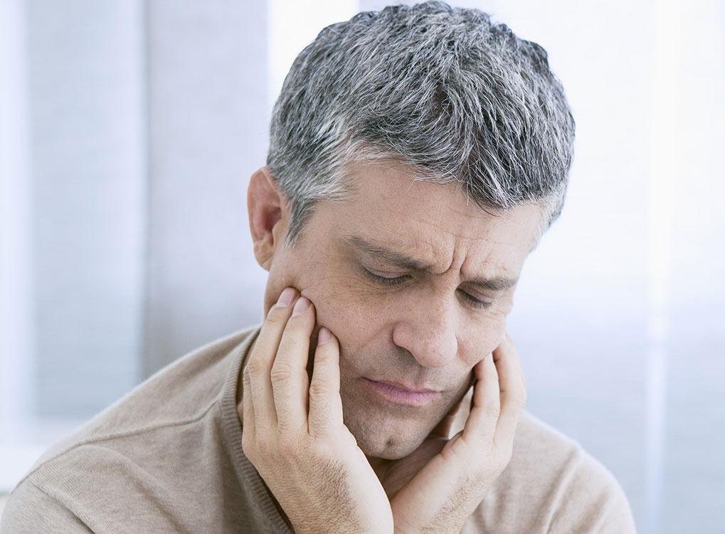 Man with Jaw Pain Dangerous Diet Fads
