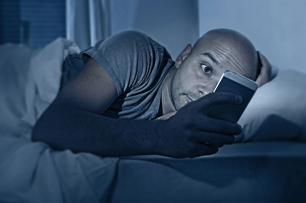 stressed out cell phone in bed