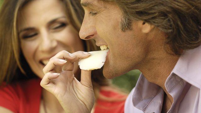 Man eating cheese