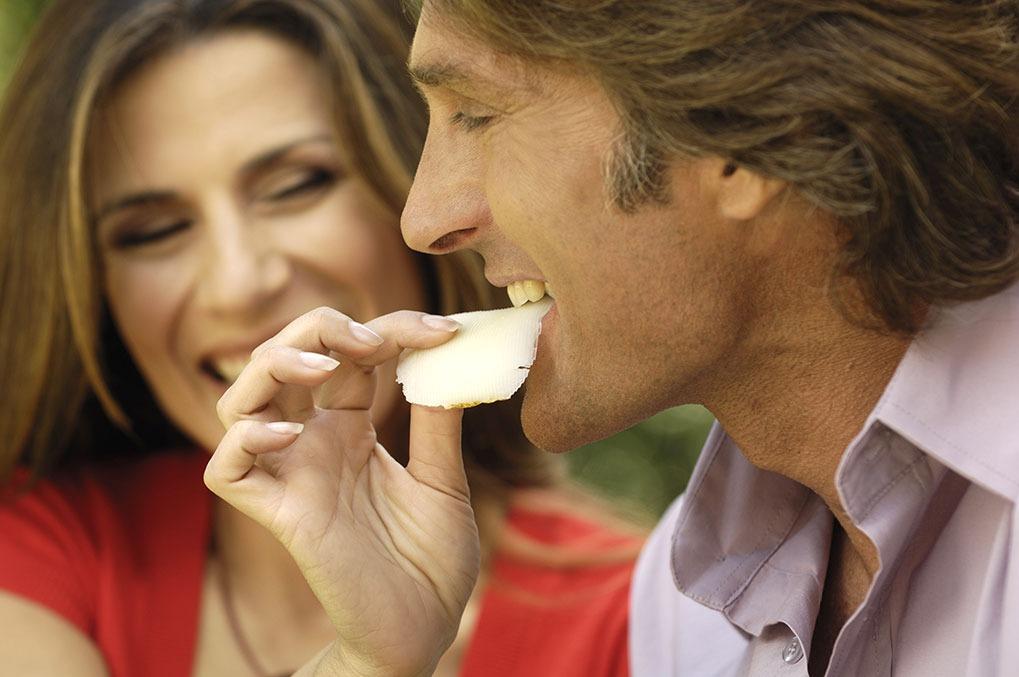Woman Feeding Man Cheese boost Metabolism